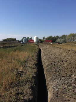Digging stock waters at Watson Cattle Company.