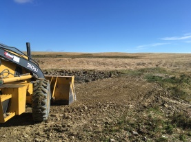 Fixing dam holes in the Cypress Hills.