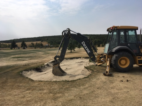 Working on bunkers at Elkwater Golf Course.