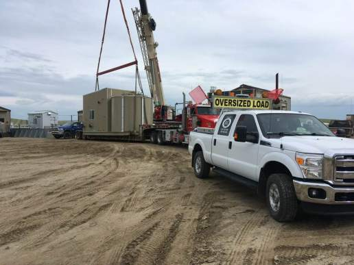 Nice way to spend a Monday, moving a little shack for the fine fellows at Stampede Crane & Rigging.